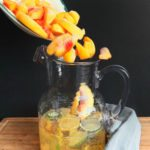 One of the easiest sangrias to make is also punched full of flavor. This spicy and sweet sangria is the perfect summer sangria. Made with Cabanero jalapeno Dry White Wine, and fresh Georgia peaches. // www.ElleTalk.com