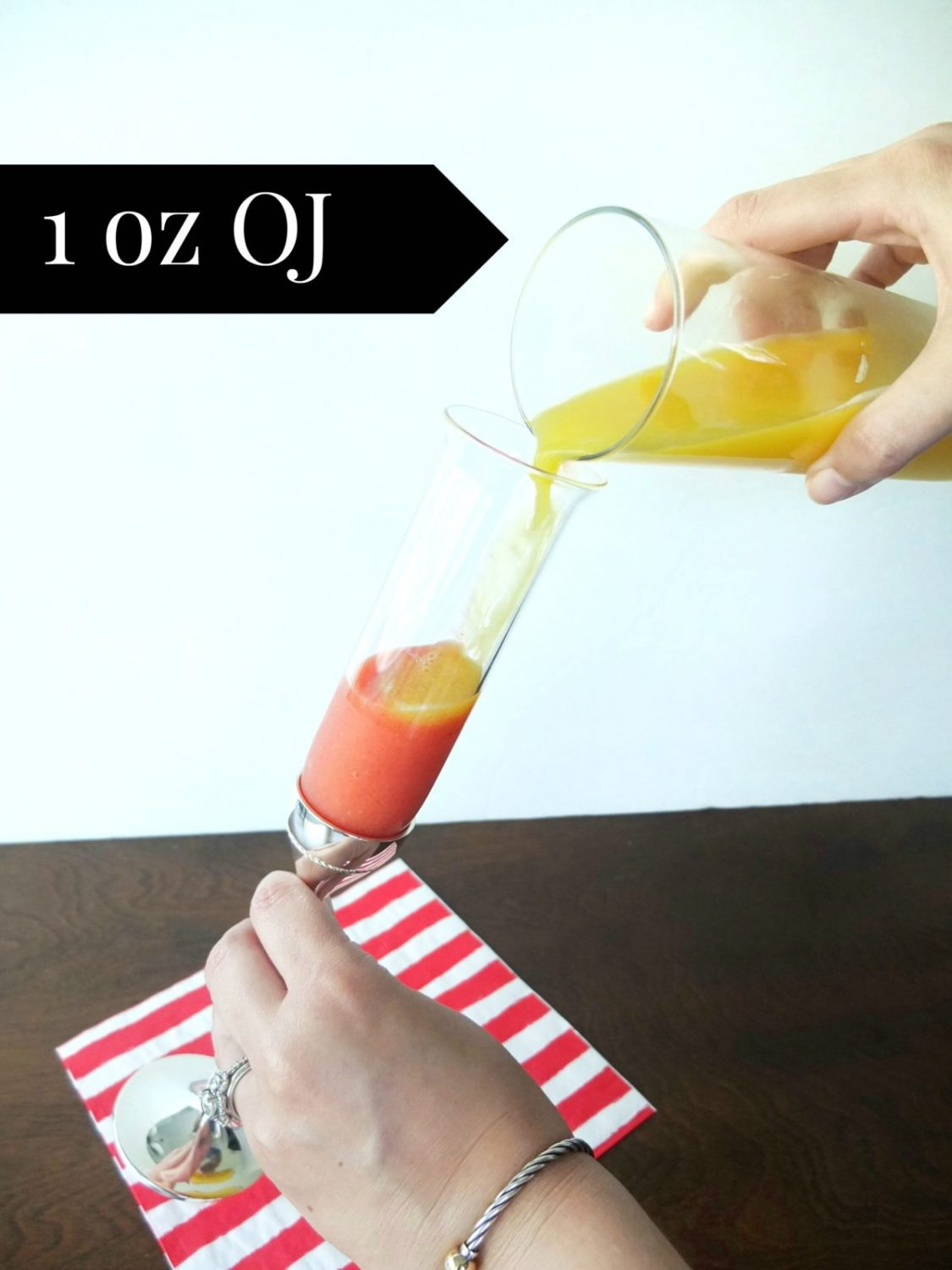 The perfect baby shower cocktail! This Babe-lini Mocktail is a fun spin on a Bellini, but since it