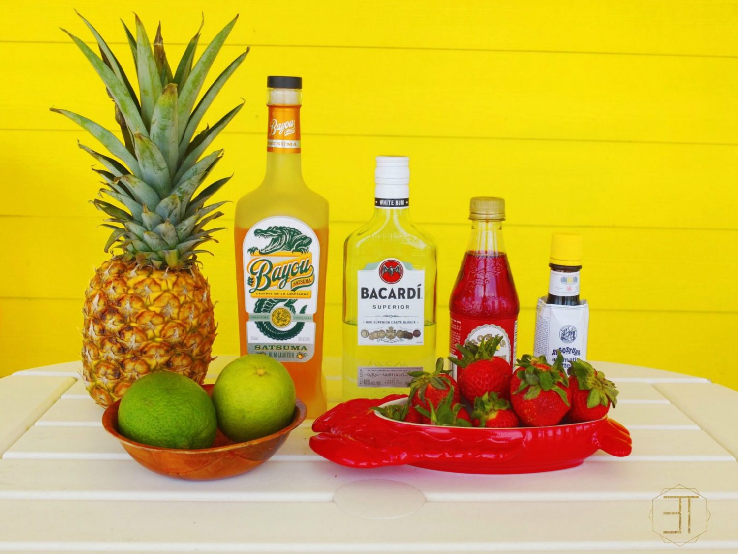 A delicious rum punch made with pineapple, satsuma, limes, and rum. This easy to make Bayou Rum Swizzle makes a delicious easy drink for the summer or themed cocktail for a luau. // www.ElleTalk.com