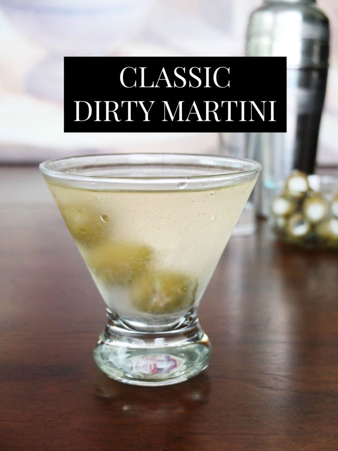 An easy and dirty martini recipe that uses garlic stuffed olive brine with blue cheese olives for a cocktail explosion. Best recipe for those who like a really dirty martini. Vodka martini or Gin Martini optional spirits. #Cocktails