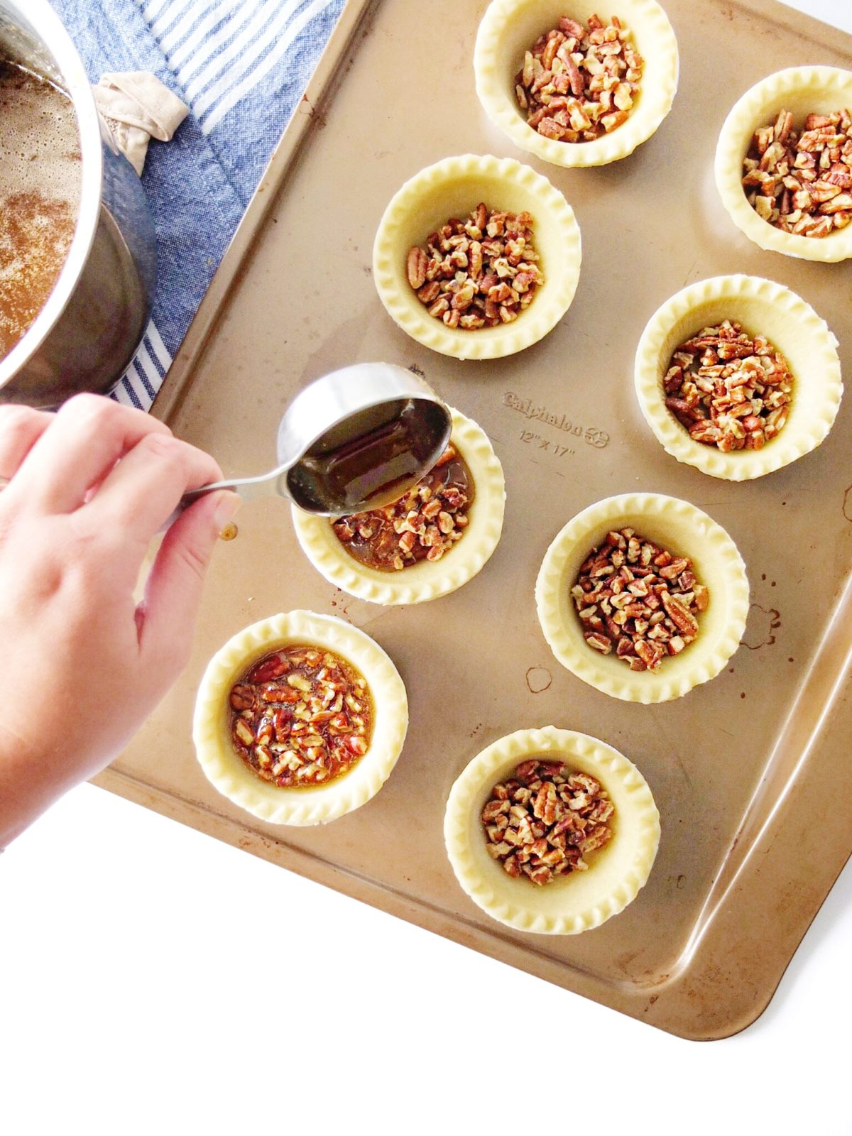 These miniature desserts are the perfect Thanksgiving recipe. Mini Bourbon Pecan Pies are easy to make. They are sweet and crunchy deliciousness! Yes, the alcohol burns out of the pies! // www.ElleTalk.com