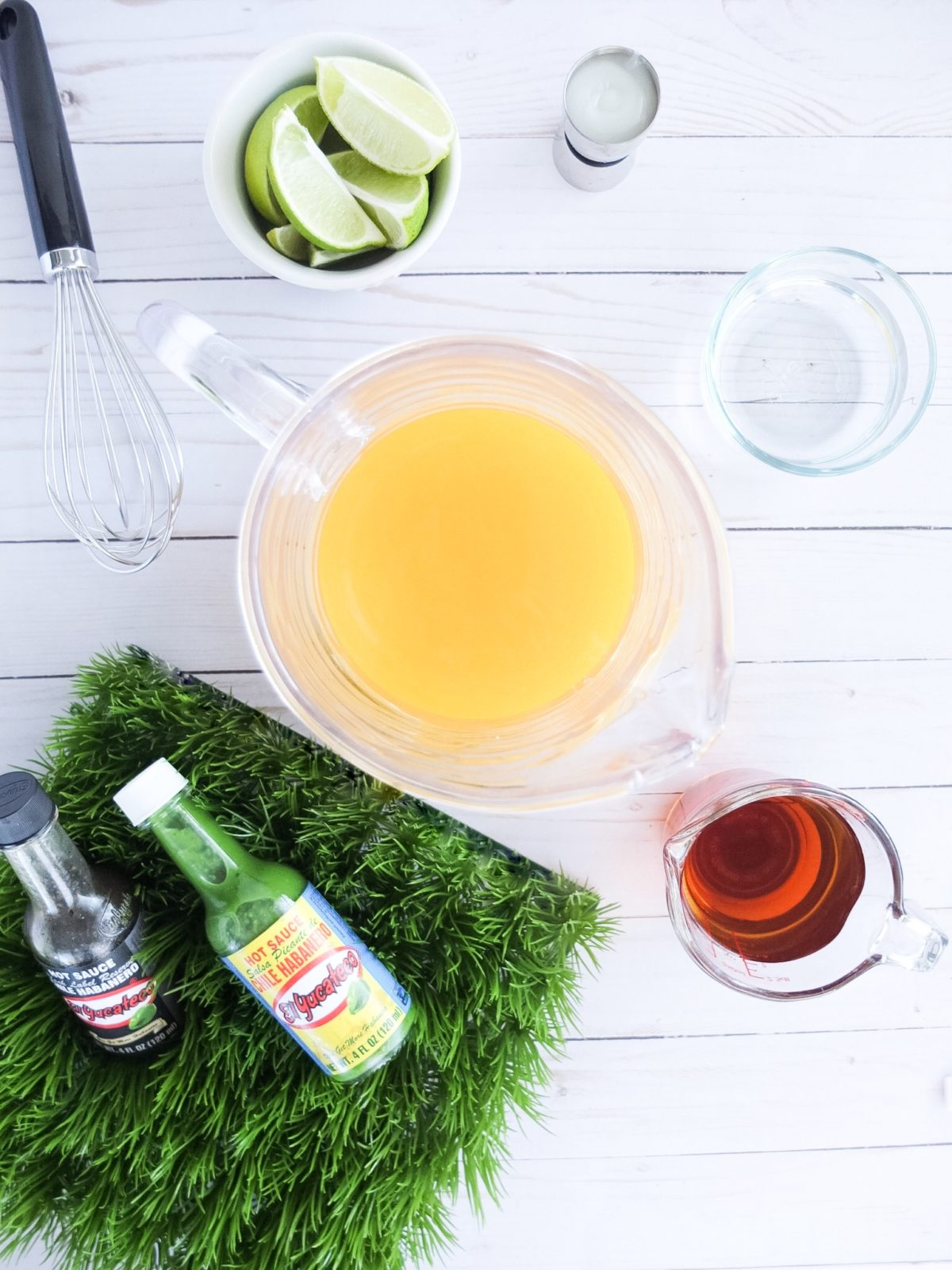 Msg 4 21+. An easy party cocktail for the Big Game! This football cocktail is a mix of flavorful El Yucateco® Green Chile Habanero flavor and a classic tiki drink! Uses pineapple juice, lime juice, dark rum, orange curacao, and cream de coconut! // www.ElleTalk.com #ad #KingofFlavor