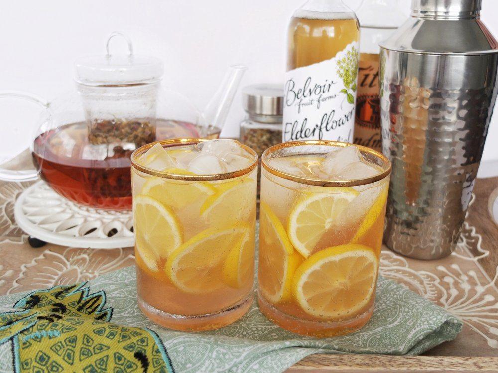 A hot or cold relaxing tea cocktail made with chamomile tea, Belvoir Elderflower Cordial, vodka, and lemon juice. #ad #worldmarkettribe // www.ElleTalk.com