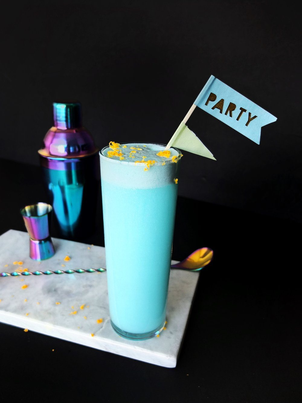A spin on a Ramos Fizz to create a teal Aquarius themed cocktail that taste like Ocean Water. // www.ElleTalk.com