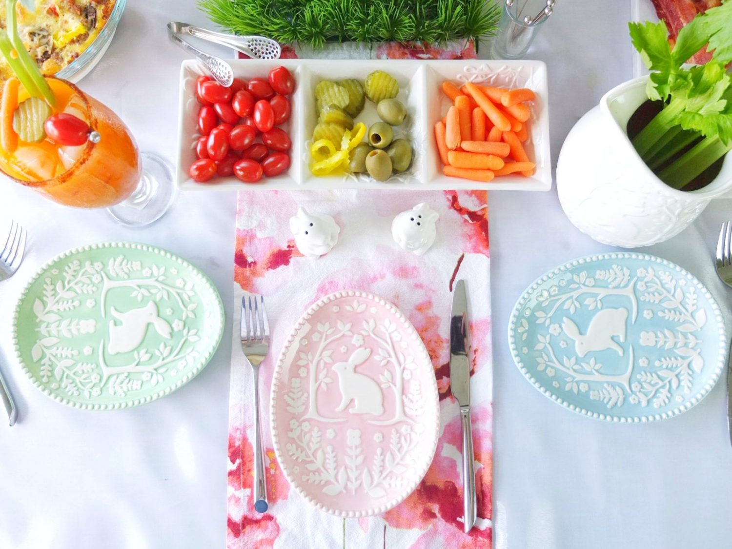 An easter brunch cocktail Bunny Mary, that is a bloody mary made with carrot juice & garnished with a celery bunny. Plus a look at my Easter Brunch tablescape with H-E-B that includes bunny muffins. // www.elletalk.com #ad #HEB
