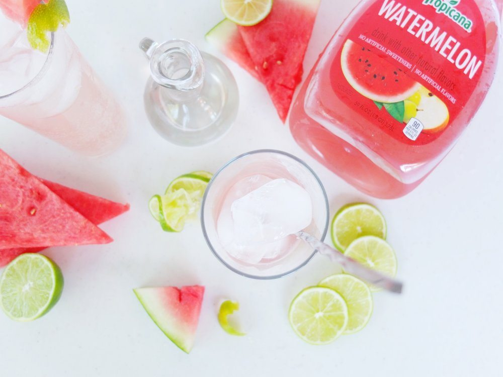 A recipe for a light, low ingredient, and easy blush colored cocktail called a Watermelon Gin Rickey made with Tropicana Watermelon. // www.ElleTalk.com #AD #21+ #MixtedWithTrop