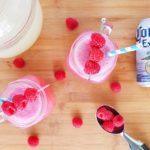 Msg 4 21+ This Frozen Raspberry Shandy beer cocktail featuring Corona Extra, raspberry sherbet, and lemonade is going to be your new go to cocktail to for a carefree summer. #ad #SummerCerveza // www.ElleTalk.com #beercocktail