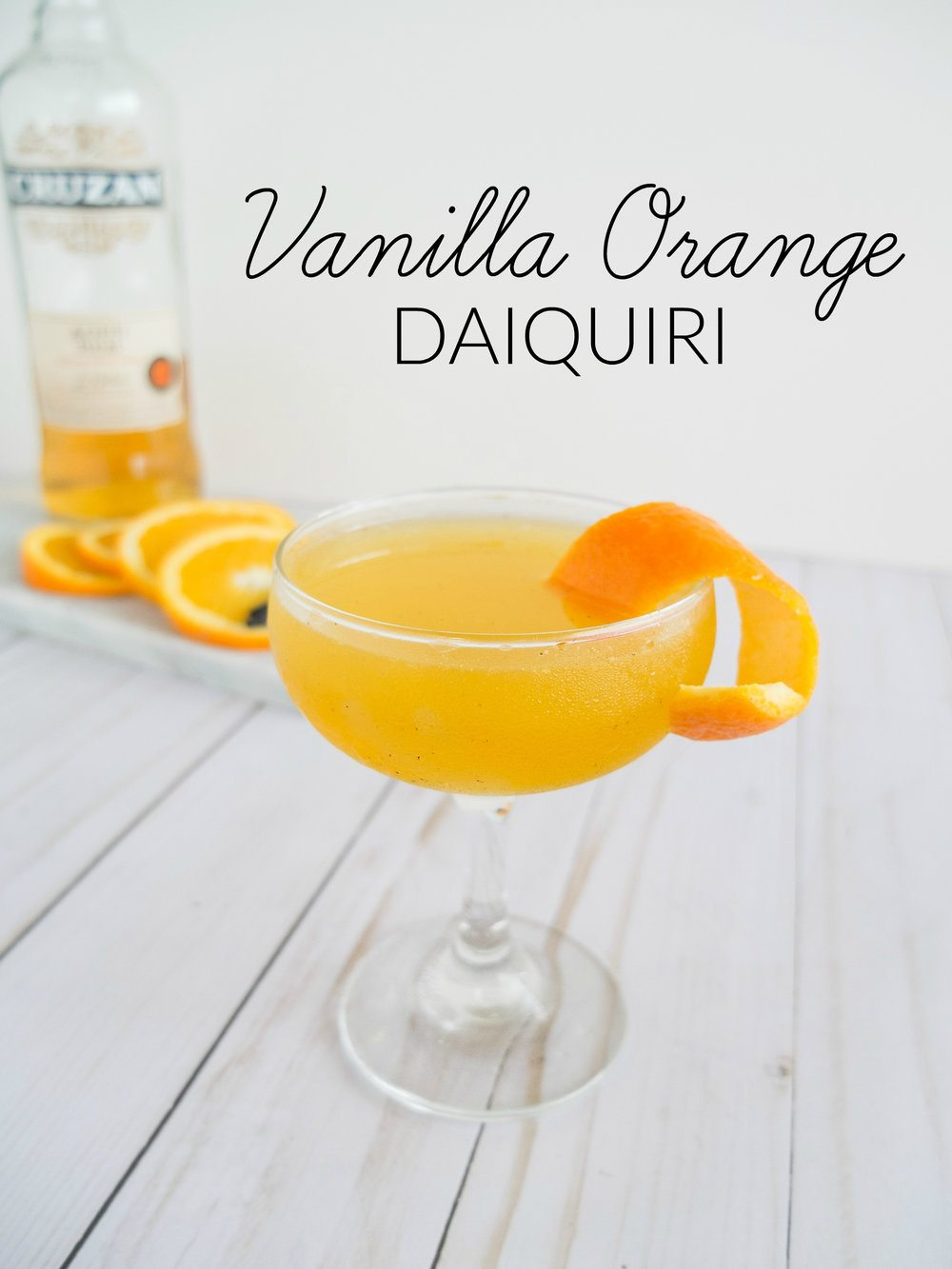An adult take on a Dreamsicle Daiquiri. This Vanilla Orange Daiquiri Cocktail is an easy rum cocktail that is sweet, bright, and warm. Using real vanilla beans, fresh orange juice, and dark rum to make a grown up version of an Orange and Vanilla Cocktail. Creamsicle Cocktail. Orange Creamsicle Cocktail. Easy Daiquiri. National Rum Day Cocktail. Dark Rum Cocktail. Easy Dark Rum Cocktail. Aged Rum Cocktail. Easy Aged Rum Cocktail. Best Rum Cocktail. // www.elletalk.com