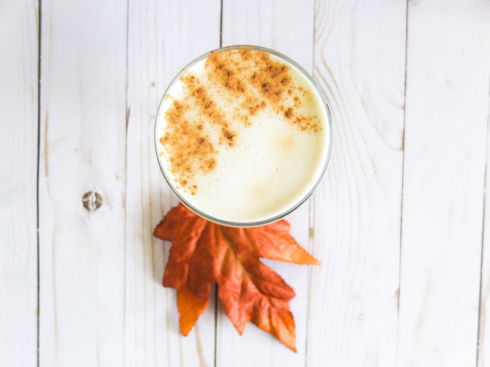 A hard cider cocktail that is bubbly and velvety with lemon juice, gin, egg whites, and simple syrup. Easy fall entertaining cocktail! Perfect and easy Thanksgiving cocktail. #thanksgiving #thanksgivingrecipe #fall #fallrecipe #hardcider #cider #fallcocktails #fallentertaining #happyhour // www.elletalk.com