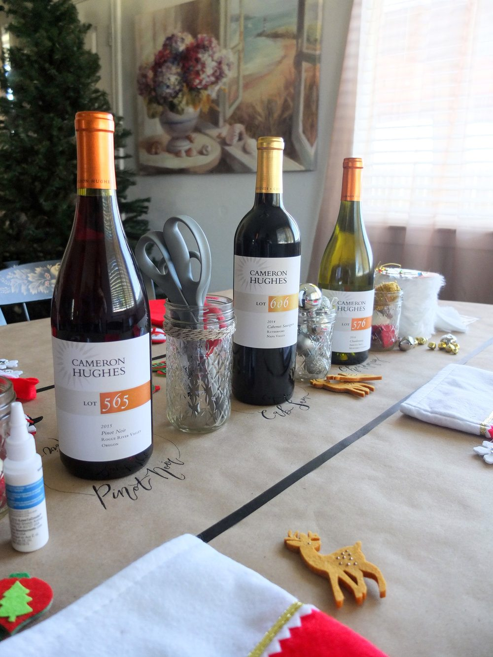 A craft and wine holiday party idea for decorating stockings and enjoying wine. Complete with free printable checklist to create your own D-I-Wine Stocking Party. Also perfect for girls night or girls wine and craft night. Great holiday party idea. Tacky sweater party idea. MSG 21+, please drink responsibly. #ad #CHWineHoliday // www.elletalk.com #holiday #holidayparty #partyideas #crafting #diy #wine #winenight #winetasting #wineparty #holidayideas #chris
