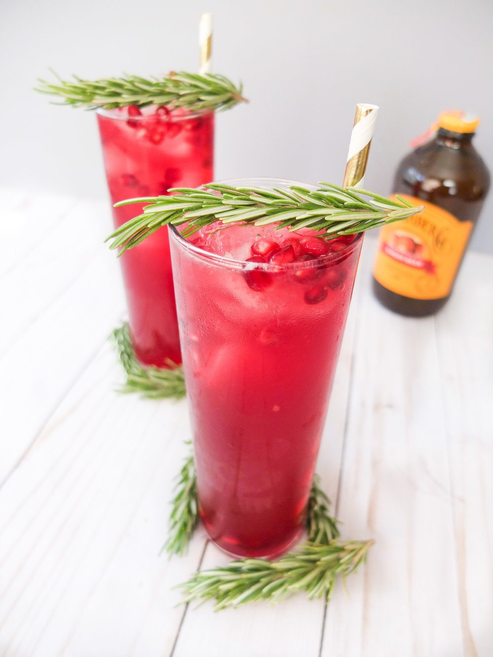 Easy Holiday cocktail similar to a holiday mule or buck. Perfect for Holiday entertaining or a Christmas Party recipe. A recipe for an easy Holiday cocktail that has Bundaberg Ginger Beer, white rum, pomegranate juice, muddled rosemary, and lemon juice. This Rudolph's Night Off is perfect for holiday entertaining or holiday drinking. // www.ElleTalk.com #spons #Bundaberg #GingerBeer #brewedbetter #holidaypartytreat #holidayrecipe #cocktailrecipe #drinkrecipe