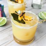 Happy #NatioanlMargaritaDay! This Charred Jalapeno Pineapple Margarita is a spicy margarita that uses smokey jalapenos to create a sweet and spicy cocktail. This pineapple margarita uses silver tequila, cointreau, agave, pineapple juice, and jalapenos. / ElleTalk