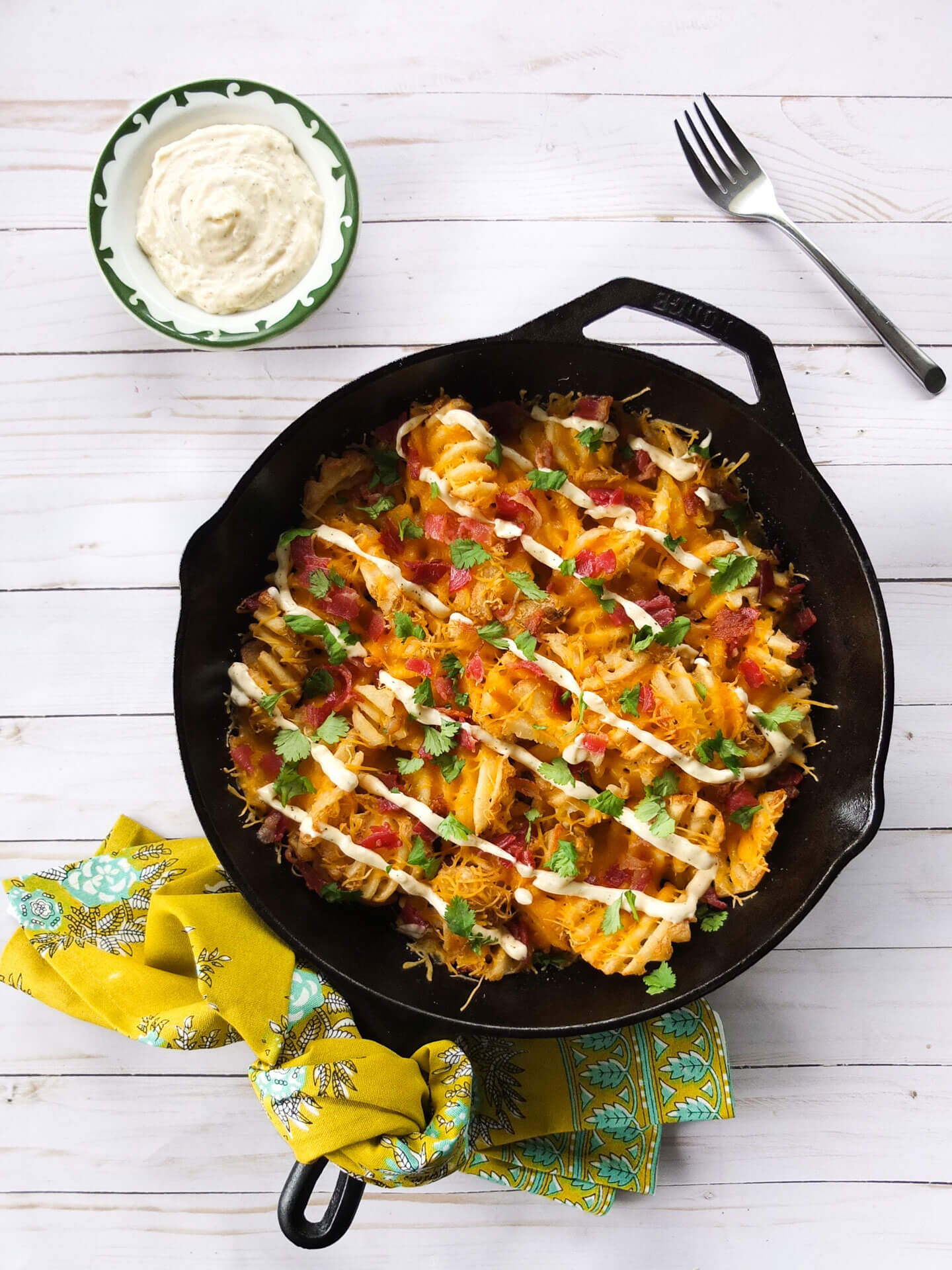 Bacon and Cheddar Loaded Fries served with a easy to make Garlic Aioli. The perfect pub food for a St. Patrick's Day appetizer.