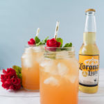 Enjoy the Big Race with this Winner's Circle Cooler! A refreshing beer cocktail made with Corona Light®, grapefruit juice, mint simple syrup, and bourbon. Perfect for sipping during The Big Race. #ad #CelebratorySips #CelebrateWithCorona