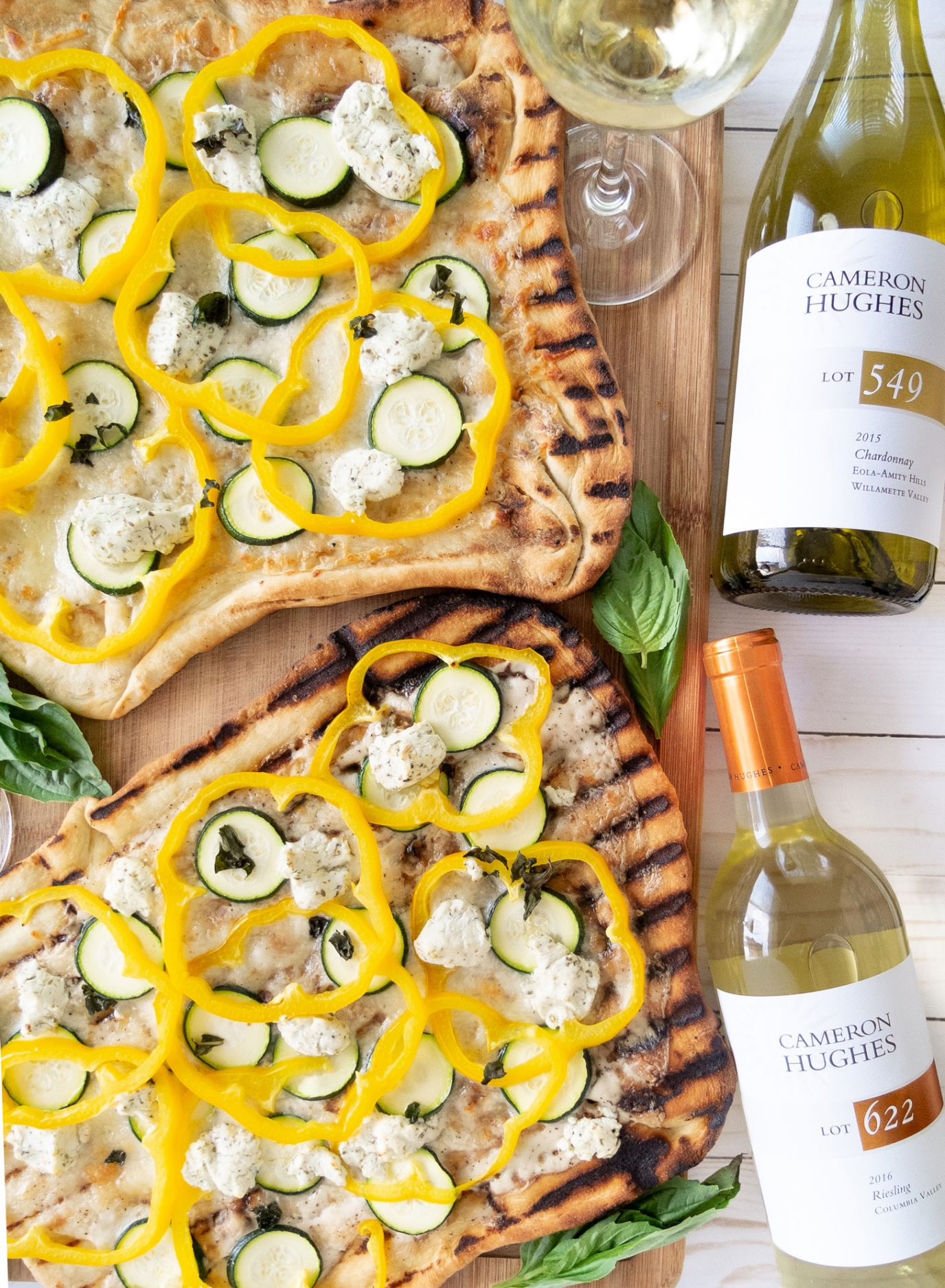 A summer stay at home date night idea. How to make yummy Veggie & Goat Cheese Pizza on the grill with your spouse while pairing crisp Cameron Hughes wines to your meal. Plus finally get the details on Brad's homemade pizza dough recipe! This post is intended for those of the ages 21+. ElleTalk #pizza #winenight #datenight #datenightideas #grillrecipes #grill #summerrecipes #pizzanight #CHWineSummer