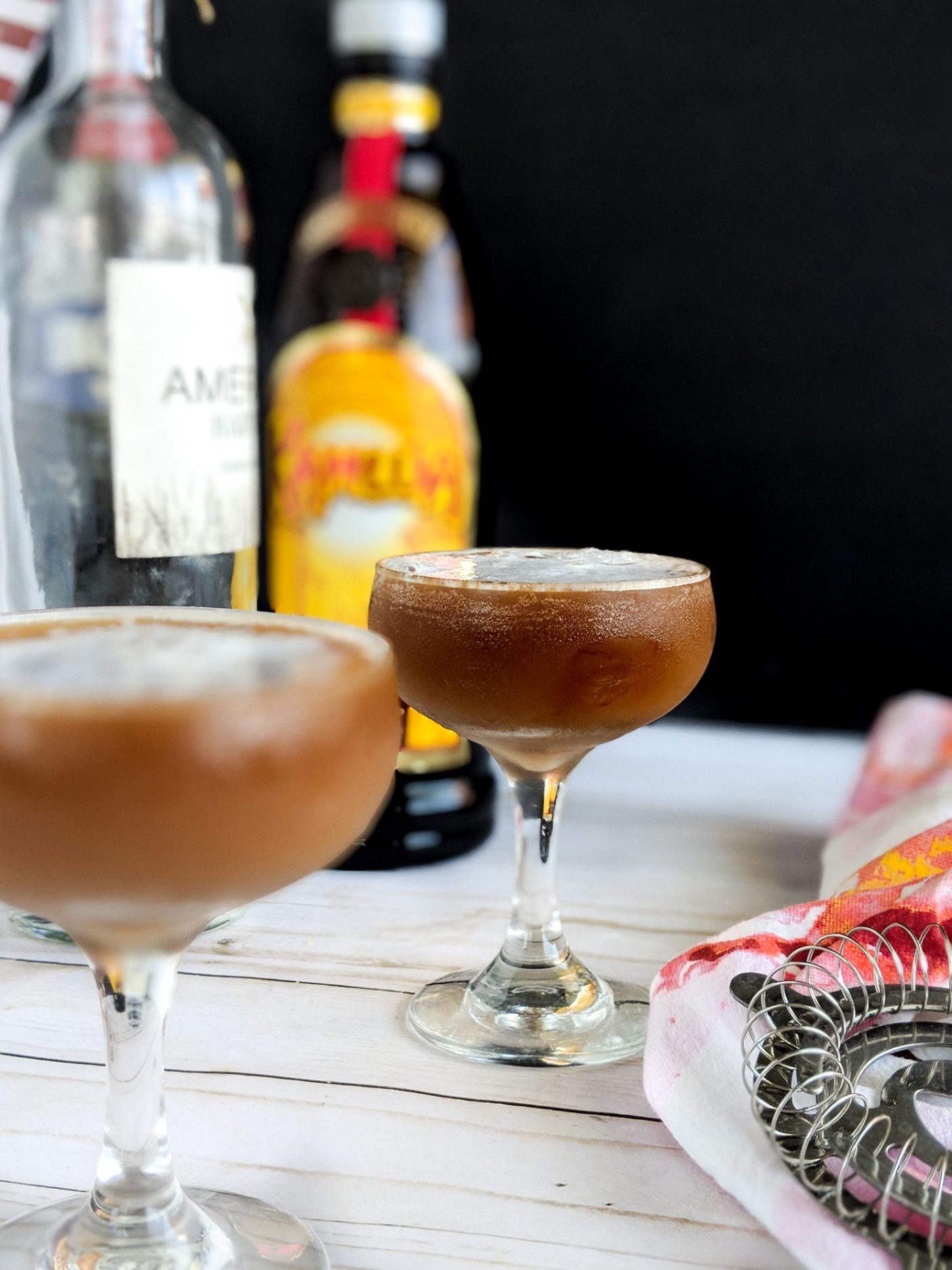 This Mocha Espresso Martini is the perfect blend of chocolate and coffee liqueurs chilled in a coup glass. This brunch cocktail is a nice change of pace from the classic Mimosa for a morning cocktail. Easy coffee cocktail. Easy vodka cocktail. #brunch #brunchrecipe #brunchcocktail #cocktail #cocktailrecipe #coffee #coffeerecipe #morning #martini #vodka #vodkacocktail elletalk