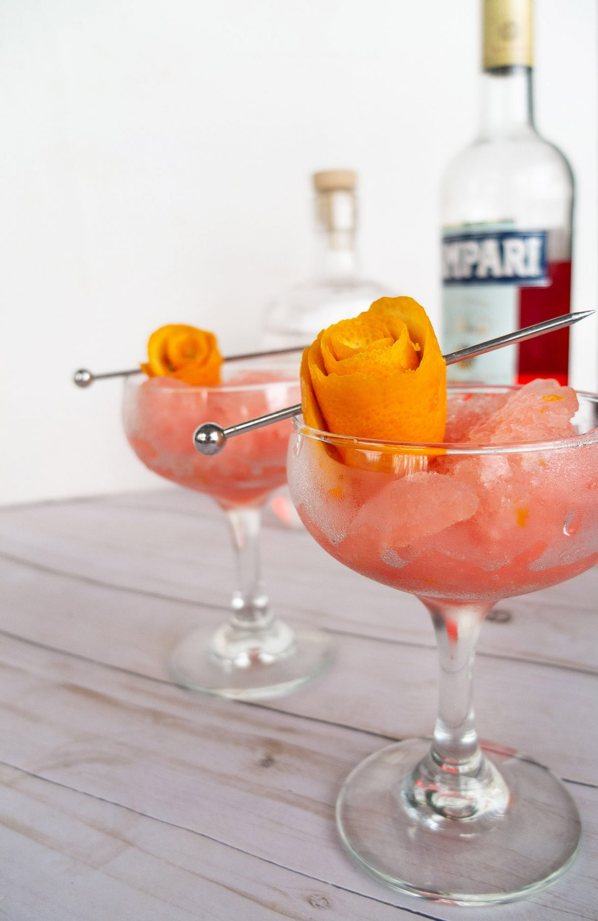 Negroni Granita! Just in time for #negorniweek, this frozen Negroni is the perfect summer cocktail. Think adult slushy meets Italian cocktail. #cocktail #cocktailrecipe #gin #aperitif #campari #granita #summerdrink