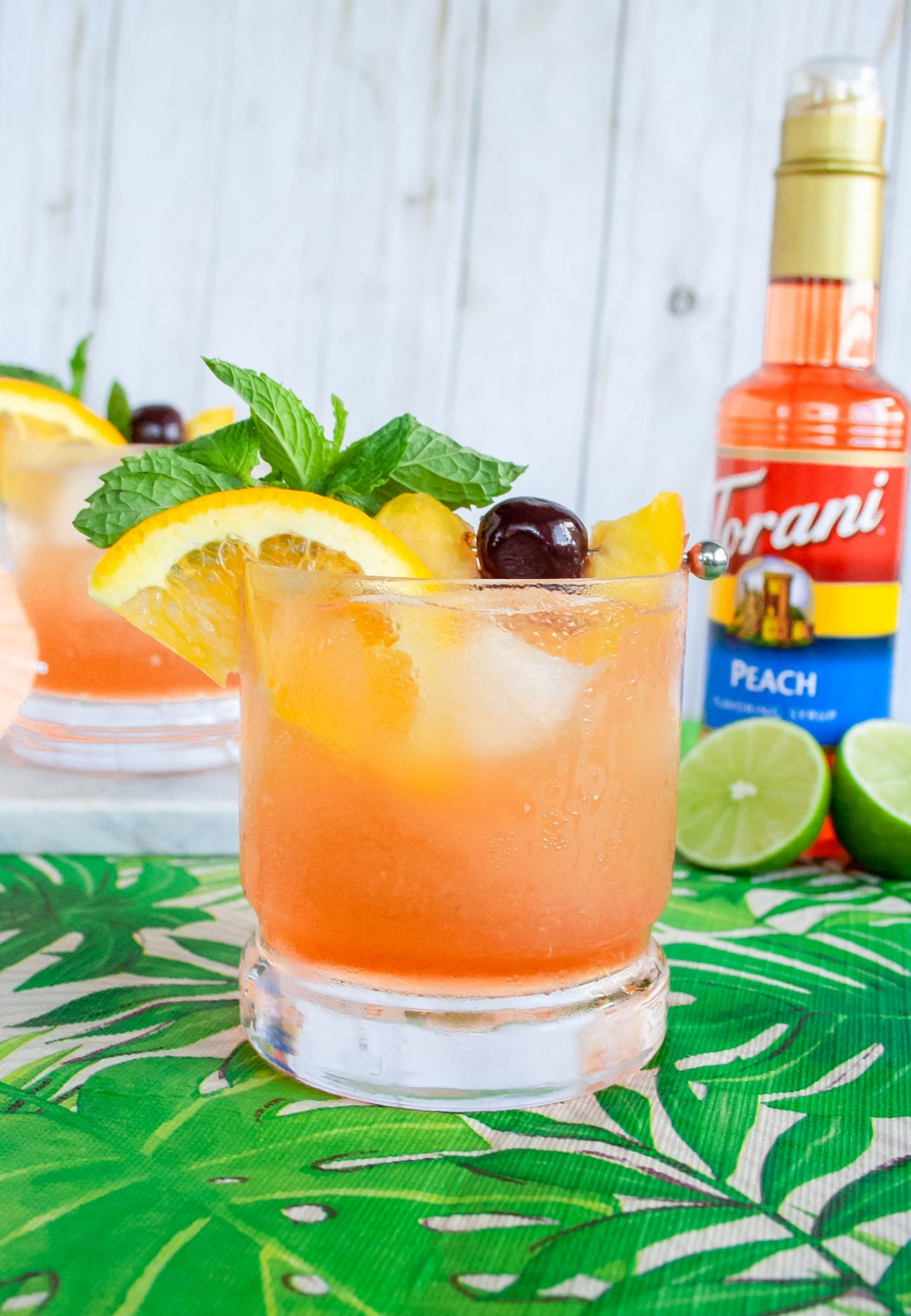 A peachy Mai Tai cocktail made easy with Torani syrup. This Torani cocktail has two types of rum and can be customized just how you like. It's an easy any time cocktail perfect for summer or winter when you are looking to whisked away to warmer days. Elle Talk| #ad #ToraniEndlessSummer #cocktail #cocktailrecipe #drink #drinks #rum #rumcocktail #summer #recipeoftheday #drinkrecipe