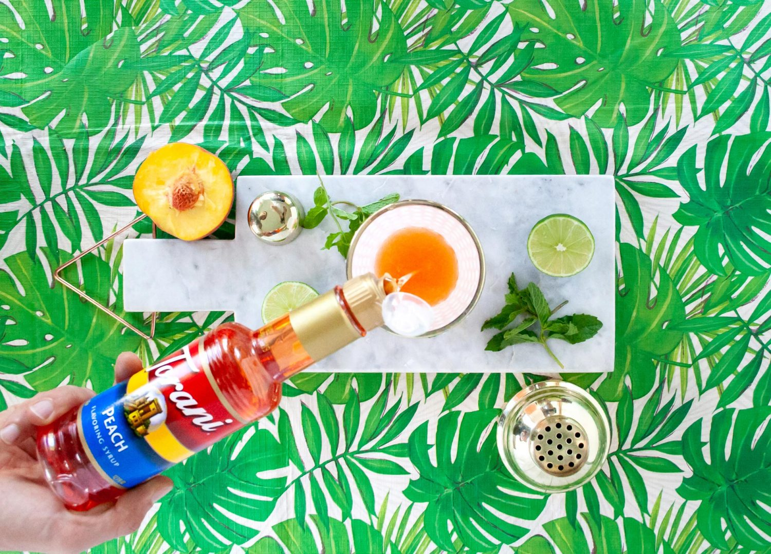 A peach Mai Tai cocktail made easy with Torani syrup. This Torani cocktail has two types of rum and can be customized just how you like. It's an easy any time cocktail perfect for summer or winter when you are looking to whisked away to warmer days. Elle Talk| #ad #ToraniEndlessSummer #cocktail #cocktailrecipe #drink #drinks #rum #rumcocktail #summer #recipeoftheday #drinkrecipe