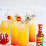 A game day tequila drink using El Yucateco Habanero Pepper sauce to make a sweet and spicy take on a Tequila Sunrise. Perfect as tailgate drink! #ElleTalk #cocktail #tailgate #gameday #tequila