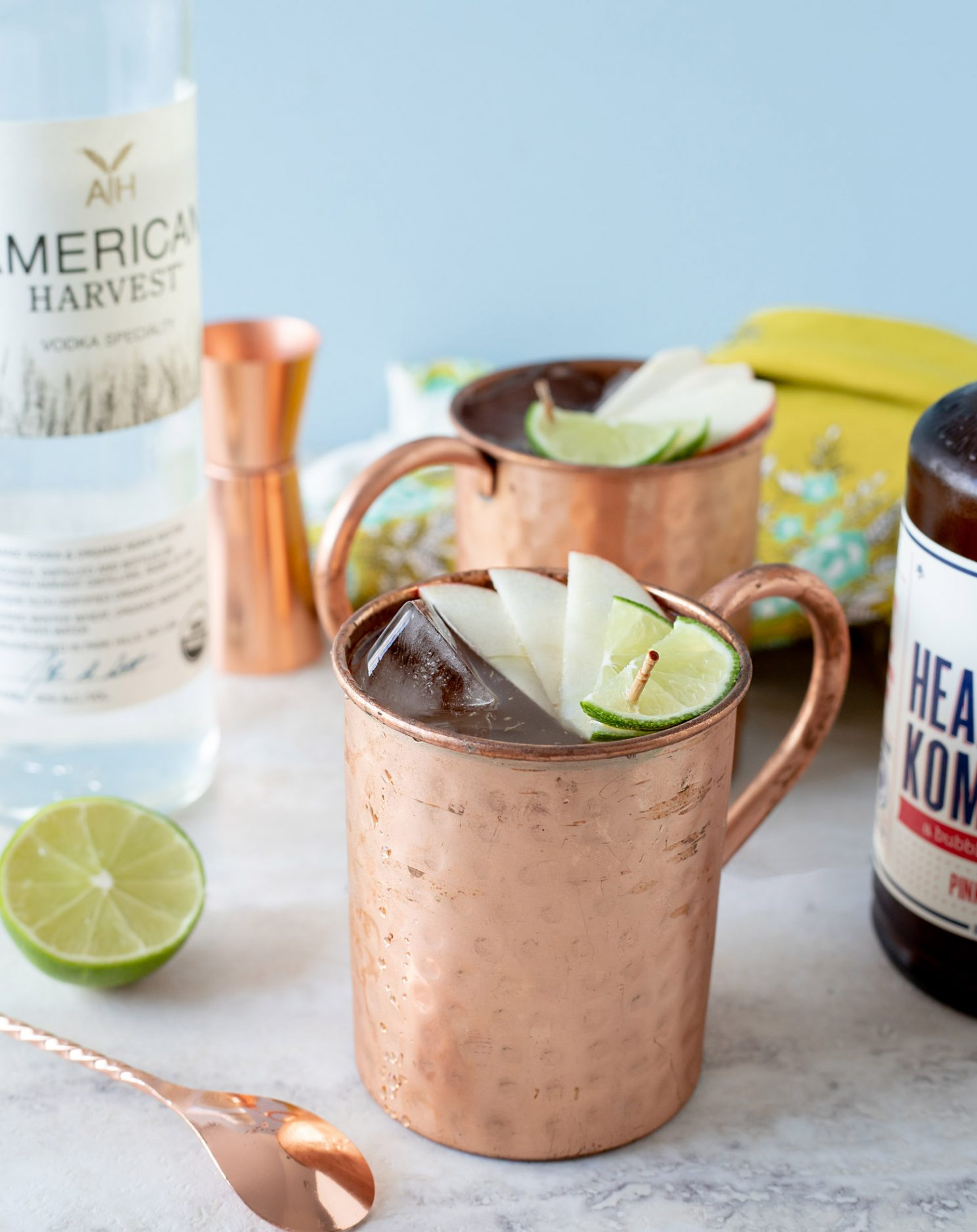 This vodka and kombucha cocktail uses Pink Lady Apple Health-Ade Kombucha for a sparkling and fruity take on a Moscow Mule. #ElleTalk #Cocktail #Kombucha #Vodka #Mule
