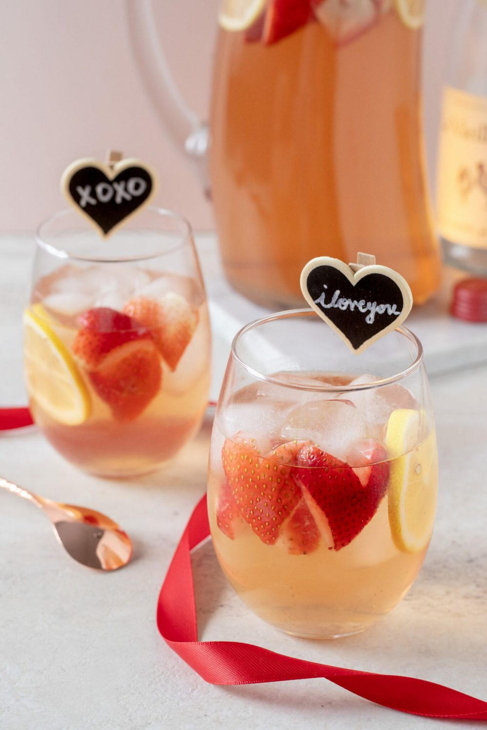 This Rosé Sangria recipe uses dry blush wine and white peach juice to make a rum sangria that is perfect for sipping for Valentine's Day or as an Anniversary wine sangria. #Sangria #Wine #Rosé #Cocktail #CocktailRecipe #ElleTalk