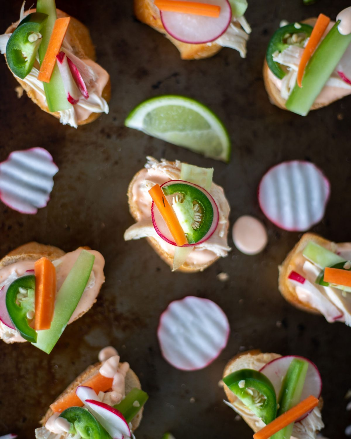 Mini Banh Mi sandwiches are the perfect appetizer for game day or party food. This take on the Veitmenease classic uses leftover rotisseriechicken to make a spicy finger food. #BanhMi #Gameday #Appetizer #PartyFood #MiniFood #PartyRecipe #ElleTalk