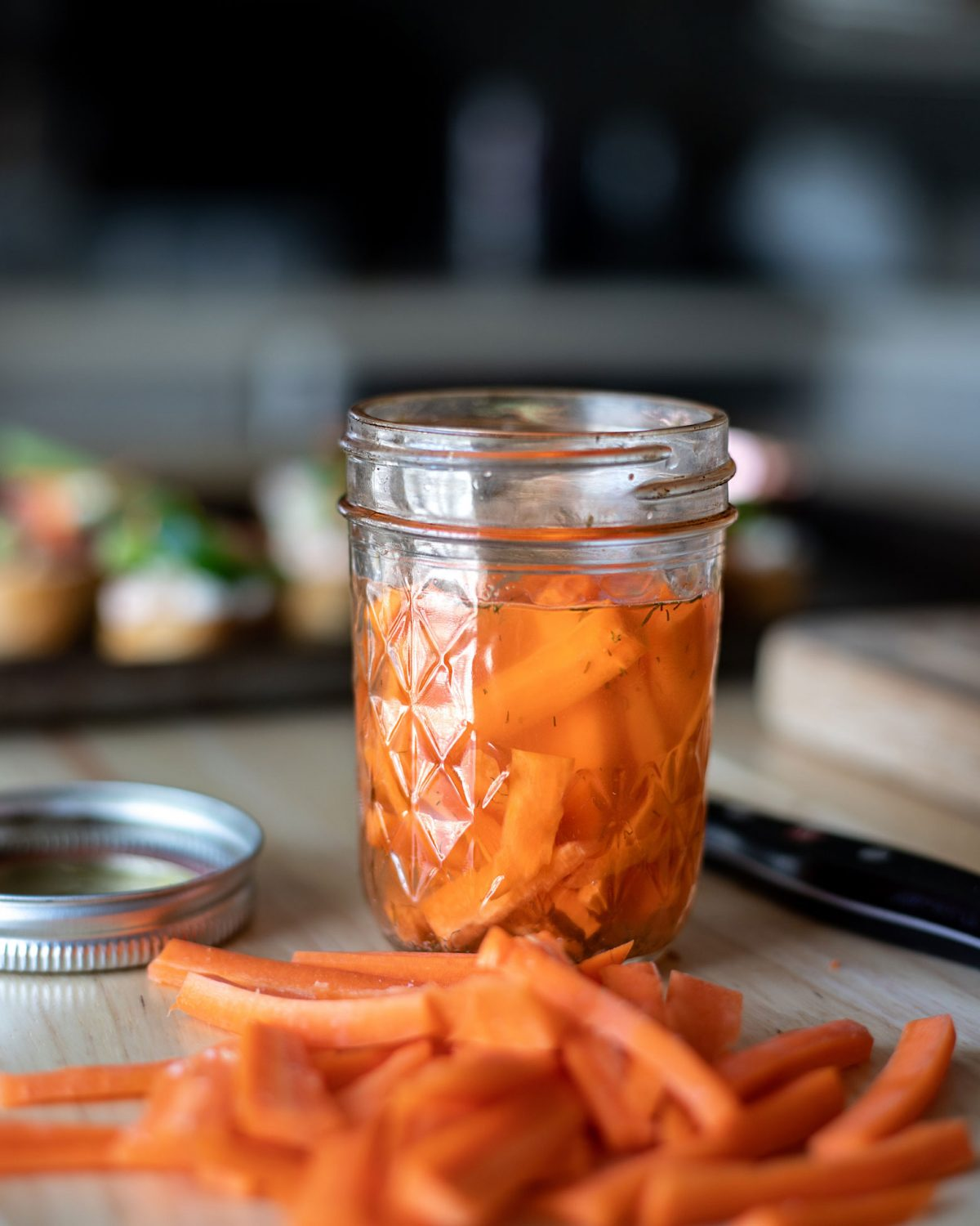 These quick pickled carrots come together in 2 hours and are perfect for banh mi or bloody marys. This quick pickling method can be used for multiple vegetables for an easy at home pickling. #Pickling #EasyRecipe #QuickRecipe #Carrots #Canning #ElleTalk