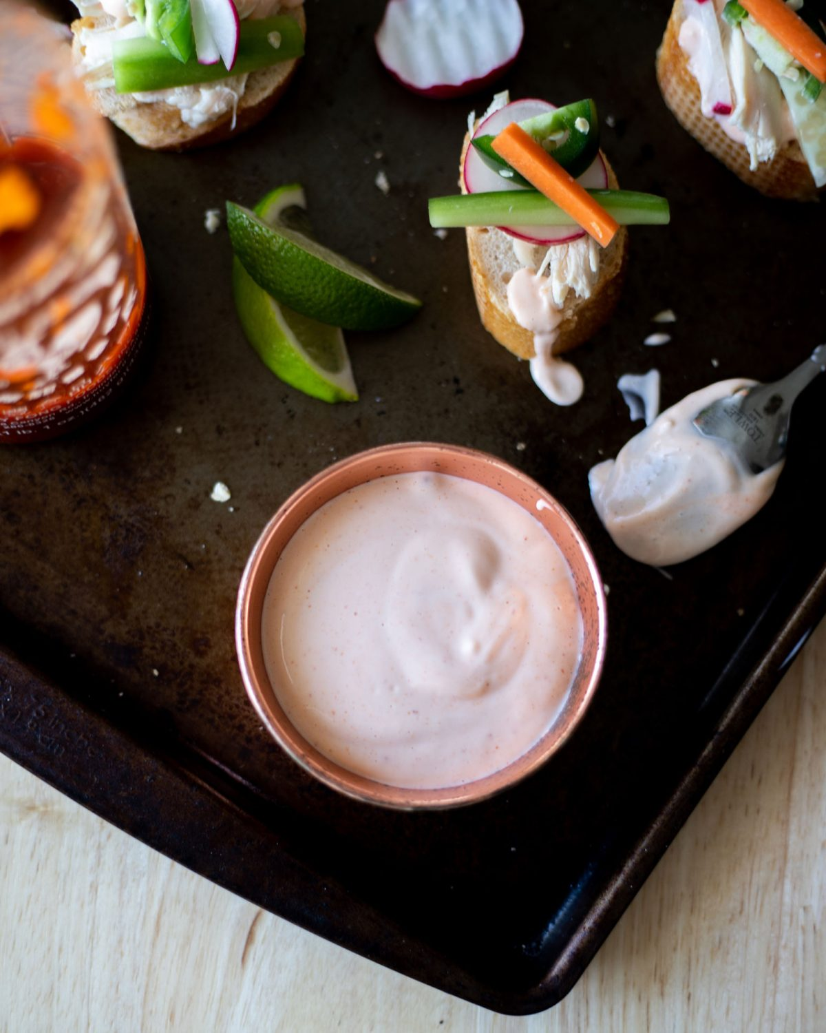 You know spicy mayo from your favorite sushi sauce but this Extra Spicy Mayo recipe has an added thai chili heat that's perfect for as a banh mi sauce, sushi, or to add to your favorite burger. #Condiment #Topping #SpicyMayo #Sriracha #Mayo #ElleTalk