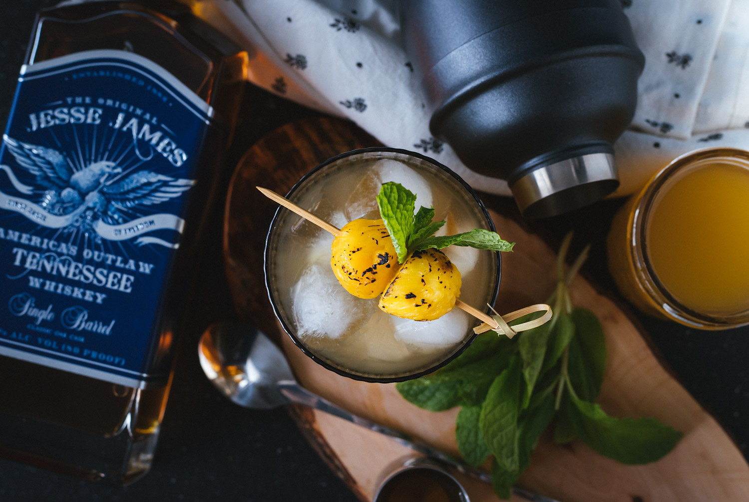 Hula Fashioned is a tiki version of an Old Fashioned using Jesse James Single Barrel Whiskey, pineapple simple syrup, bitters, and a sweep of mint. It's a boozy cocktail with notes of smokiness, fruit, and a hint of mint. #sponsored #jessejameswhiskey #jessejamessinglebarrel #ElleTalk #CocktailRecipe #Whiskey #OldFashioned