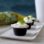 The Irish Coffee Cocktail turned jello shot just in time for St. Patrick's Day. These Irish Coffee Jello Shots are jello flavored coffee and Irish whiskey with a whip cream topping. Elle Talk #Whiskey #JelloShots #Cocktails #Cocktailrecipes #StPatricksDay