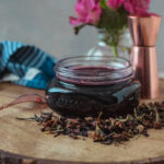 Recipe for hibiscus simple syrup using equal party hibiscus brewed tea and sugar. Perfect for cocktails and flavoring sparkling water or a unique ice cream topper. #ElleTalk #SimpleSyrup #Hibiscus #HibiscusCocktail #HibiscusSyrup #FlavoredSyrup