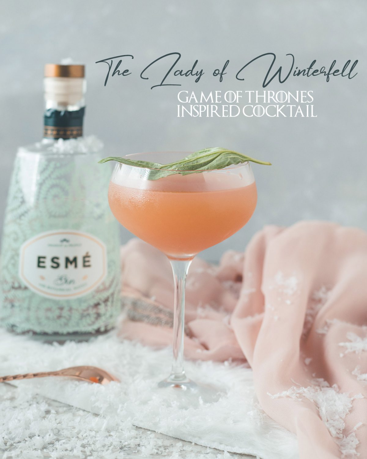 This Lady of Winterfell cocktail is a Game of Thrones inspired cocktail is perfect for a Game of Thrones party. This grapefruit and gin cocktail is muddled with basil to be a delightfully refreshing pink martini recipe. Inspired by one of my favorite characters, Sansa Stark and her pink King's Landing dress. #ElleTalk #GameofThrones #GameofThronesParty #Gin #GinCocktail #CocktailRecipe #DrinkRecipe #Grapefruit