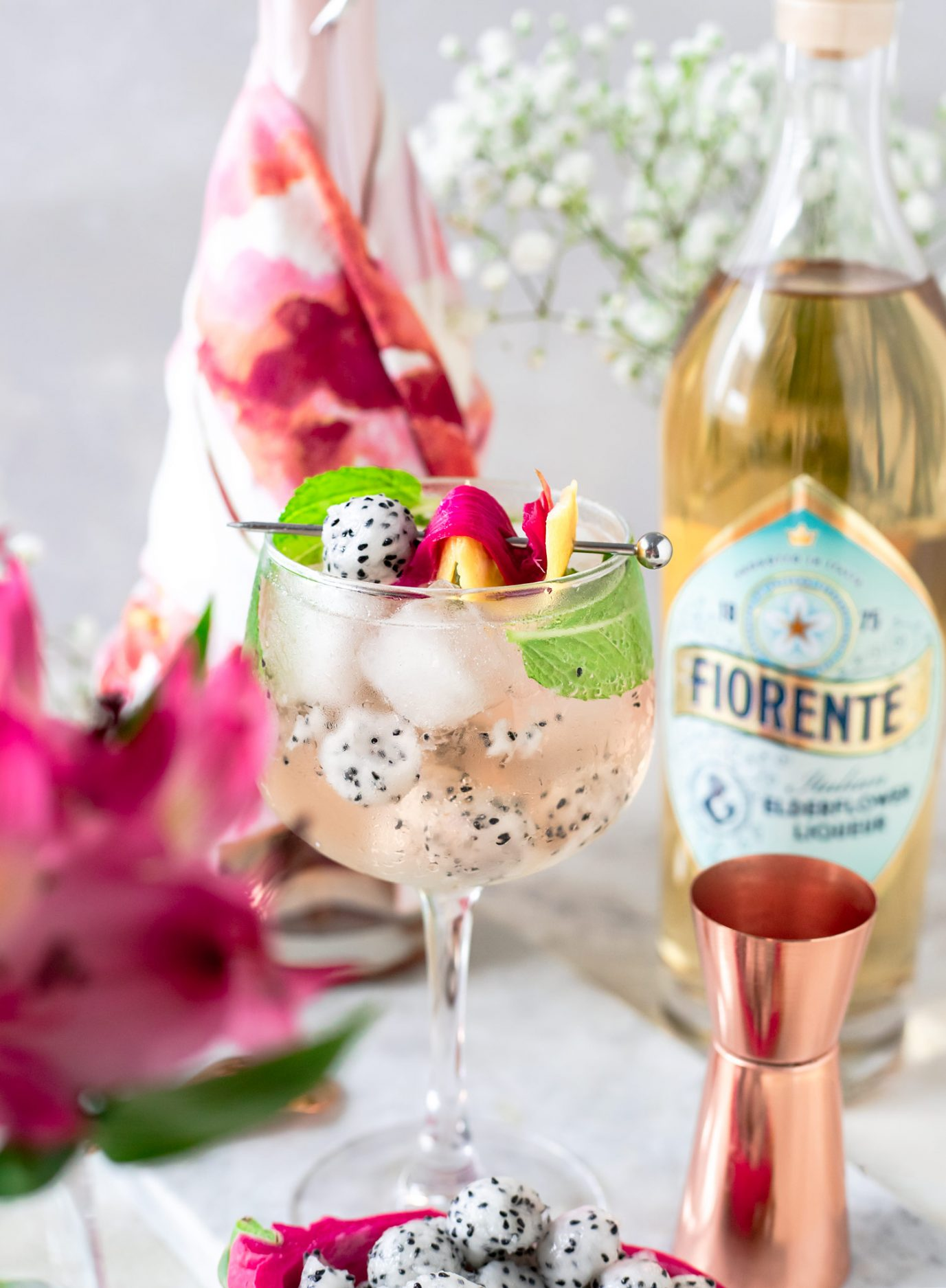 Spritz cocktail season is here and this Rosé Dragon Fruit Spritz is a riff off the classic with bubbly rosé, Fiorente Elderflower Liqueur, mint, citrus, and dragon fruit for a light and bubbly cocktail recipe. #Spritz #Elderflower #ElleTalk #ItsSpritzSeason #CocktailRecipe #DrinkRecipe #Sponsored