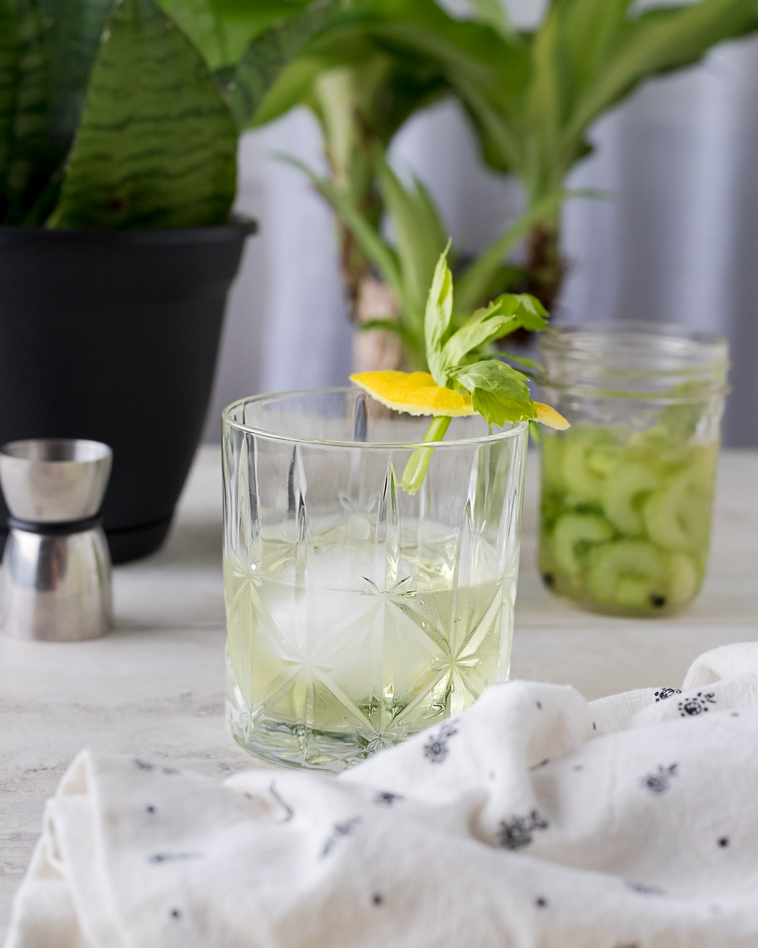 This white negroni recipe uses celery infused gin for an earthy spin on the original cocktail making for a delightfully bright and bitter drink. Negroni Week Cocktail. #Negroni #Celery #CeleryJuice #Gin #GinCocktail #CraftCocktail #CocktailRecipe #DrinkRecipe #NegroniWeek