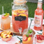Frosé Beer Punch is a summer punch perfect for a BBQ or end of summer party. This easy beer punch is a refreshing mix of wood-plank grilled fruit, white rum, strawberry beer, and Master of Mixes Frosé Mix. #ElleTalk #MasterofMixes #SummerEntertaining #PunchRecipe #CocktailRecipe #BeerCocktail #Beer #Rum #RumDrink