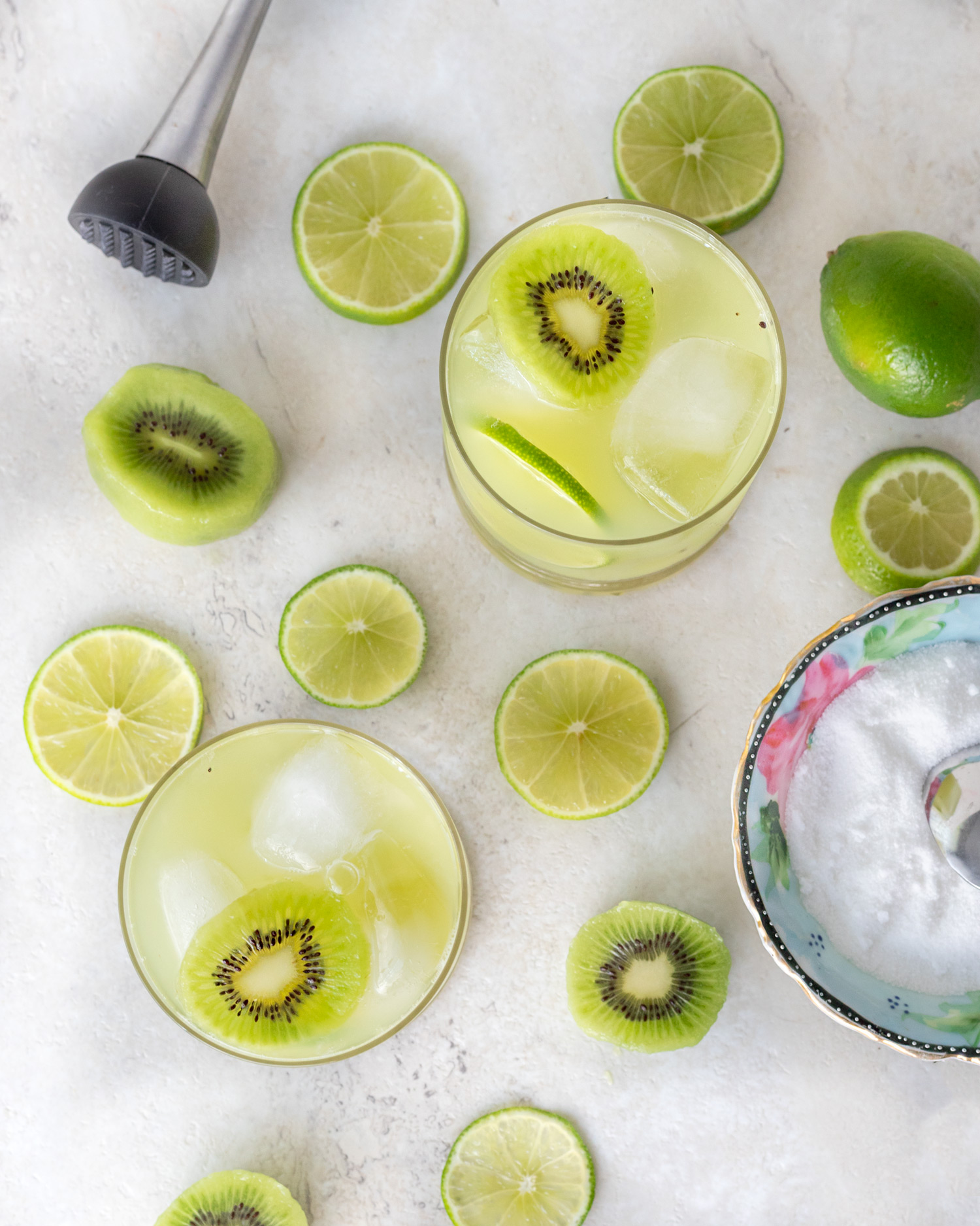 Kiwi-Caipirinha is a classic cachaça cocktail with a fruity spin on it. This tart and sweet cocktail is perfect for late summer sipping and is an easy cocktail recipe that anyone can make. #ElleTalk #cachaça #cocktailrecipe #drinkrecipe #summerrecipe #latesummerrecipe