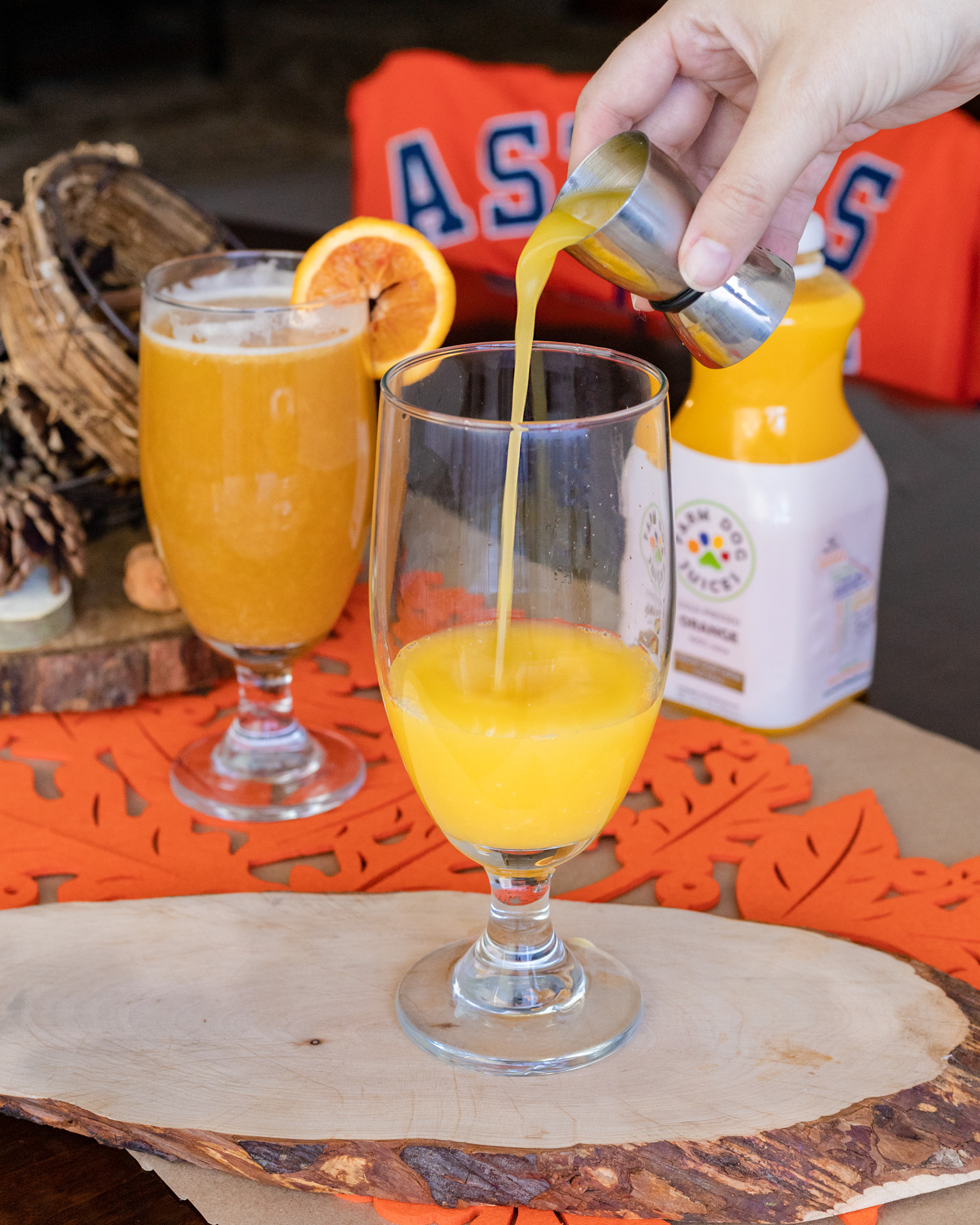 The Astros are going to the World Series so we're celebrating with a World Series cocktail. This beer cocktail using Karback's Crawford Bock, tequila, orange juice, and bitters for a beer cocktail that is a home run. #BeerCocktail #Beer #CocktailReecipe #ElleTalk #DrinkRecipe #Tequila #Vodka
