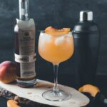 A whiskey and peach cocktail spiced with ginger beer, spiced simple syrups, and lemon juice for a cocktail that is spicy, earthy, and sweet. A fall bourbon cocktail you're just going to love. #ElleTalk #FallRecipe #cocktailrecipe #bourbon #BourbonCocktail #FallCocktail #Whiskey #WhiskeyCocktail