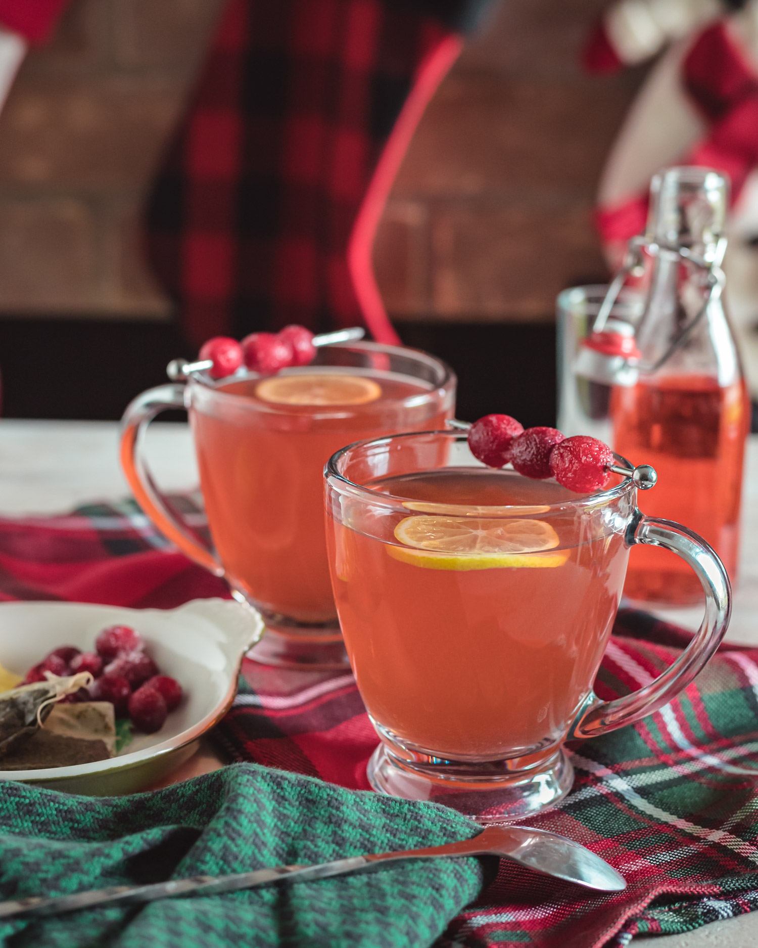 Cranberry Mint Tea Cocktail is a mint tea cocktail made with cranberry vodka, lemon juice, and simple syrup. It's the perfect winter hot cocktail recipe. Elle Talk #cocktailrecipe #drinkrecipe #tearecipe