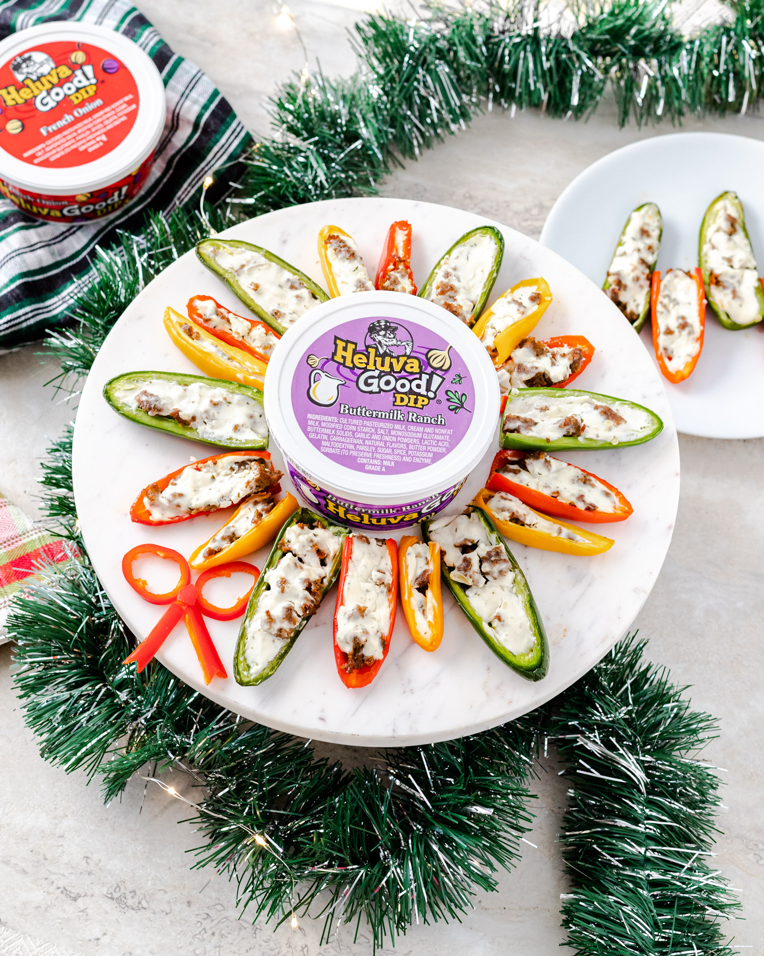 Easy 4 Ingredient Holiday appetizer for spicy stuffed peppers filled with Italian hot sausage and Heluva Good French Onion Dip. Baked and then ready to serve with a side of Heluva Good Buttermilk Ranch Dip. #sponsored #ElleTalk #HolidayEntertaining #HolidayAppetizer #EasyAppetizer #HotSausage #StuffedPeppers #FrenchOnionDip